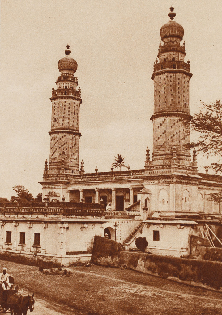 Sepia-toned photograph of the white mosque of Tipu Sultan at Srirangapatna with its two octagonal minarets.