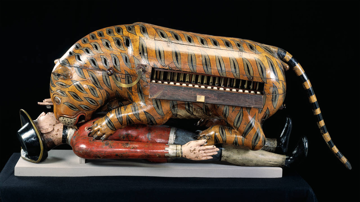 Tipu's Tiger - A stylised wooden tiger attacking a soldier.