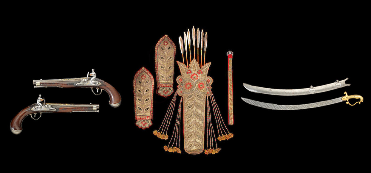 Tipu Sultan's weapons and armour - two pistols, intricately decorated amour pieces, a curved sword and scabbard.